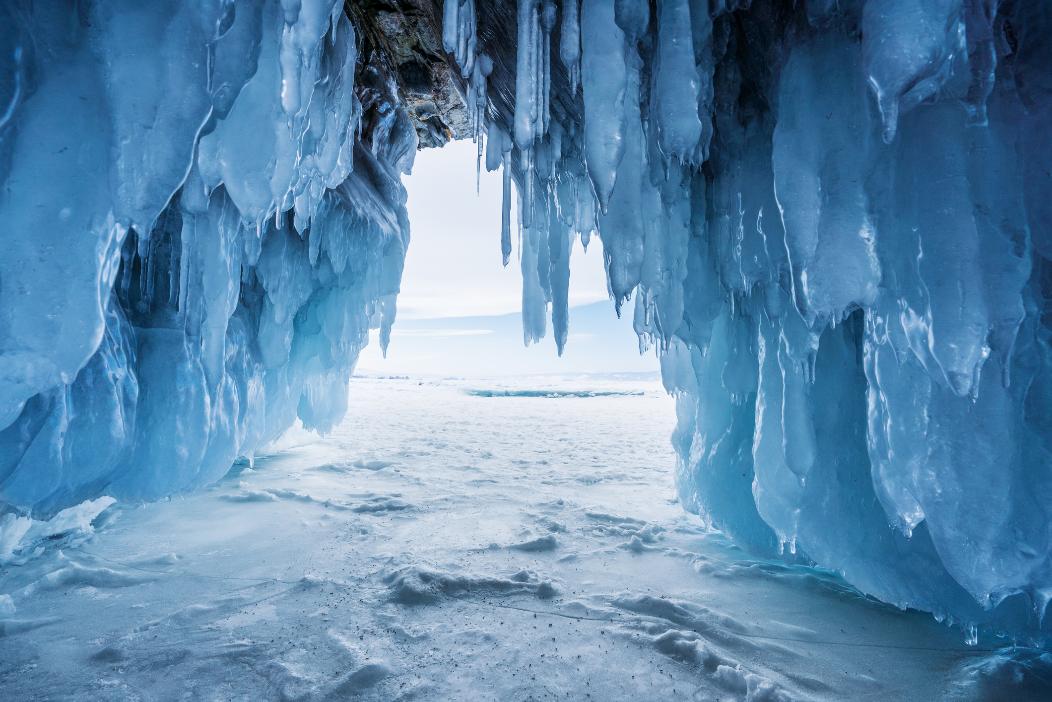 Frozen ice cave with bright sunlight