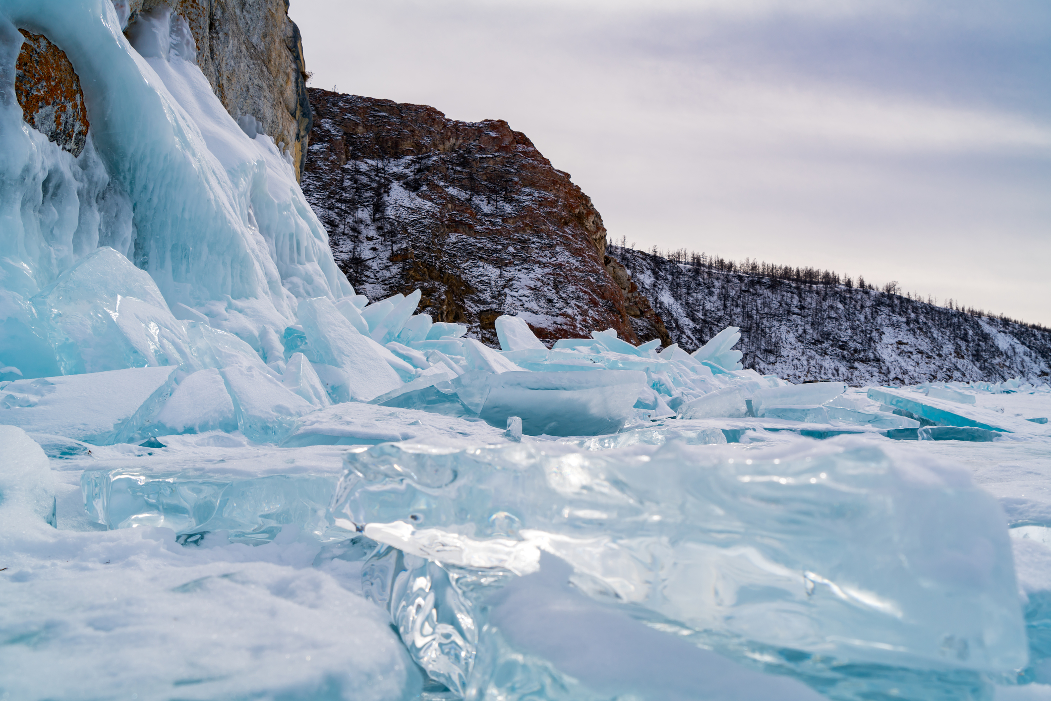 Ice blocks covered with snow at Frozen Lake Baikal