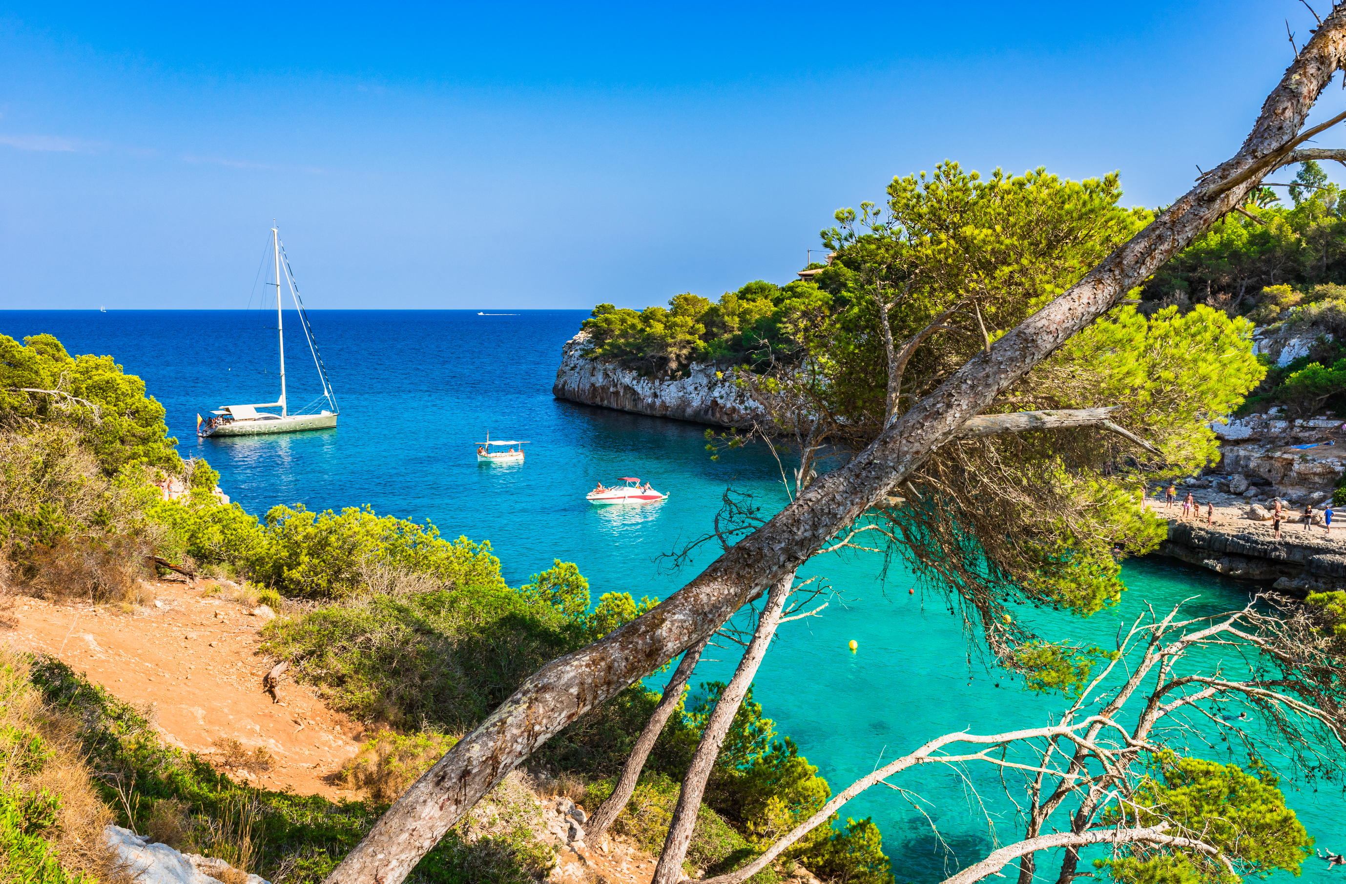 Spain Majorca Cala Llombards idyllic bay with boats