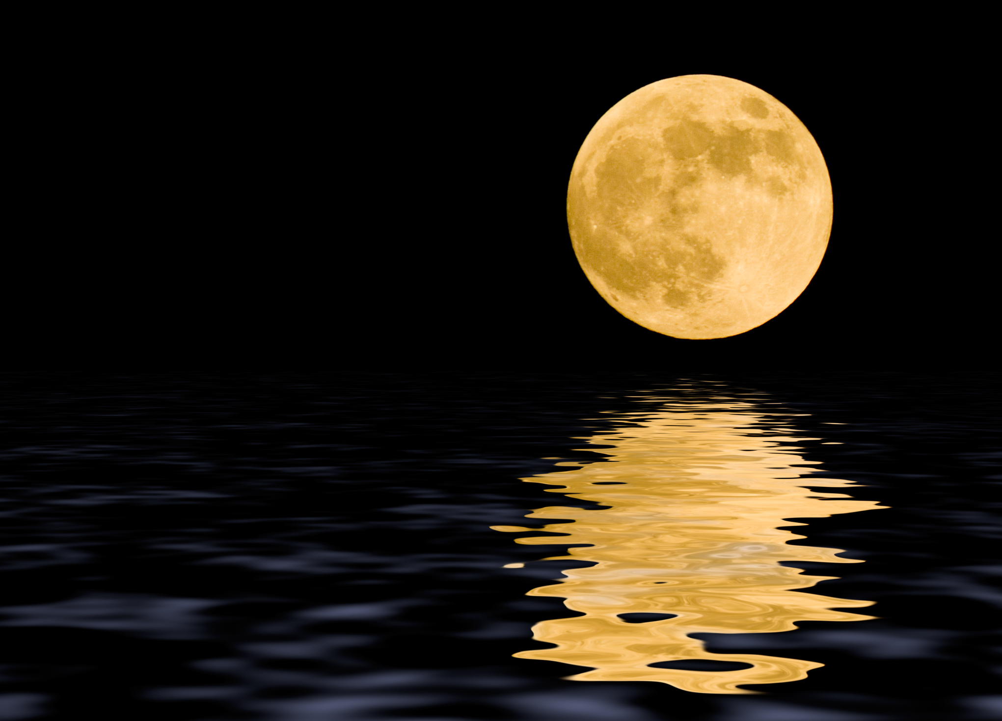 Moon at midnight with some reflections in the water