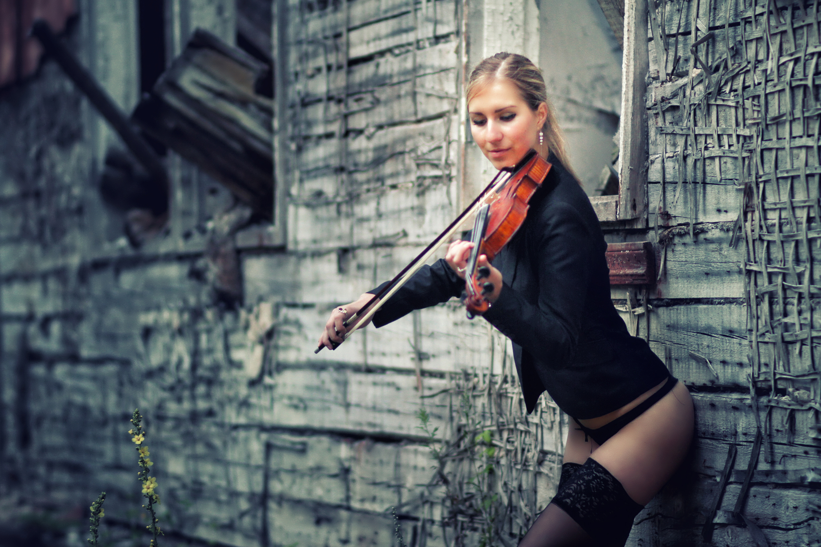 Russian girl playing violin in a provocative manner