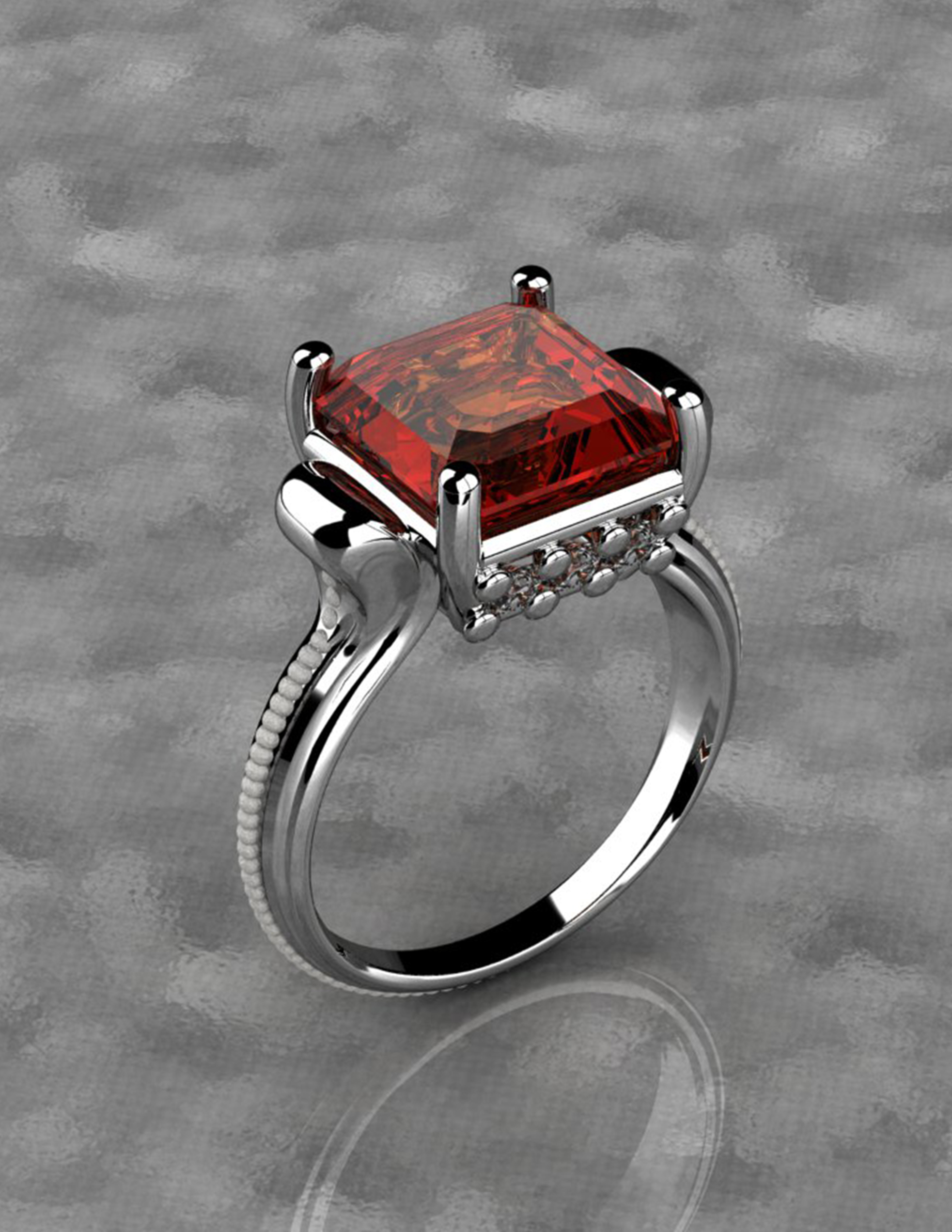 Silver ring with red diamond
